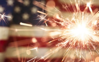 Sparklers against a United States flag background